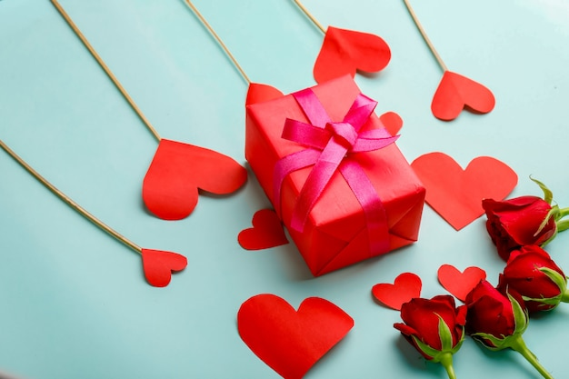 Gift box, little heart and red rose with background. valentine day concept