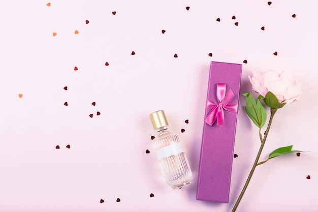 Gift box, perfume, flower, decorative hearts and