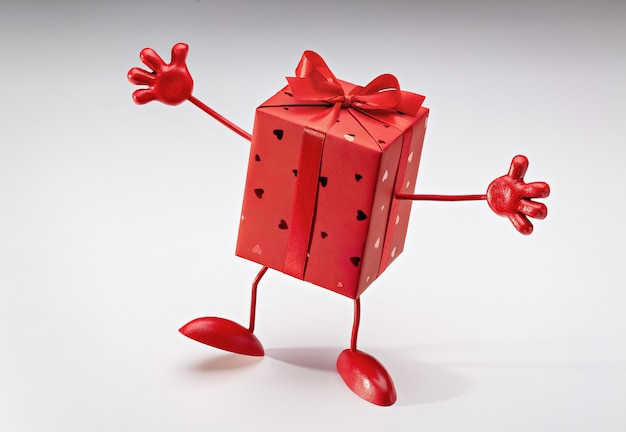 Gift in box. red box on legs, with handles. cartoon figure. copy space.