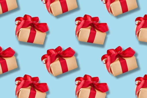 Gift box seamless pattern on blue background