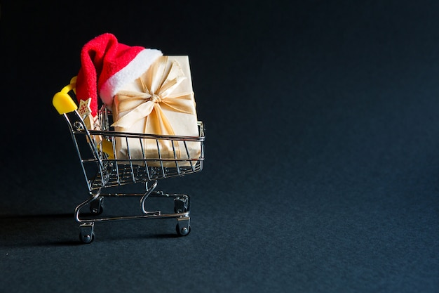 Gift box in shopping cart for christmas