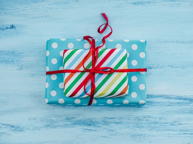 Gift box, tied with a red ribbon
