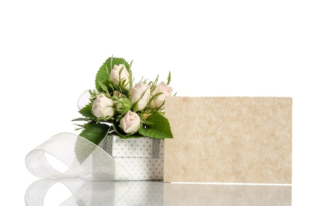 Gift box and white roses with empty card