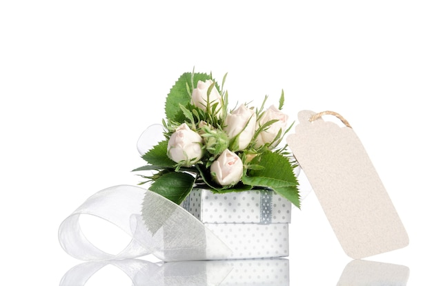 Gift box and white roses with empty tag