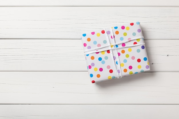 Gift box on white wooden background