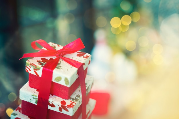 Gift box with blurred background. merry christmas, happy new year or happy birthday backgr