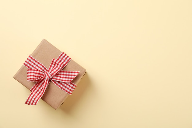 Gift box with bow on color background, space for text