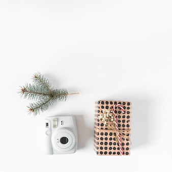 Gift box with camera on table