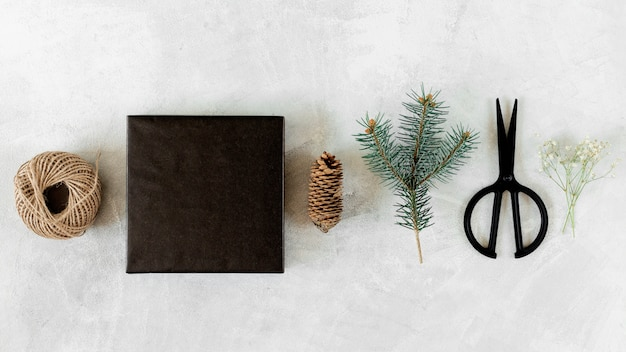 Gift box with christmas decoration on grey table
