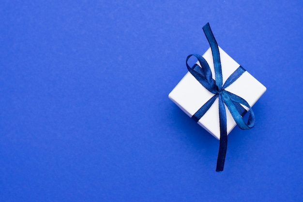 Gift box with classic blue bow