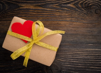 Gift box with Golden ribbon and red heart, Valentine's day
