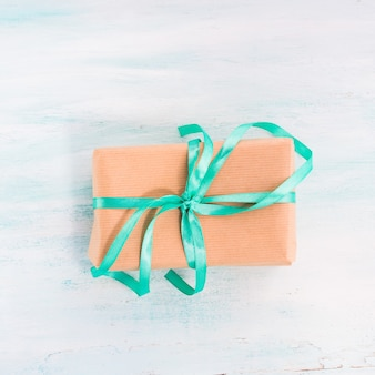 Gift box with green ribbon pastel. holiday present