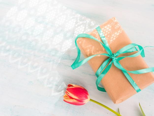 Gift box with green ribbon pastel. holiday present