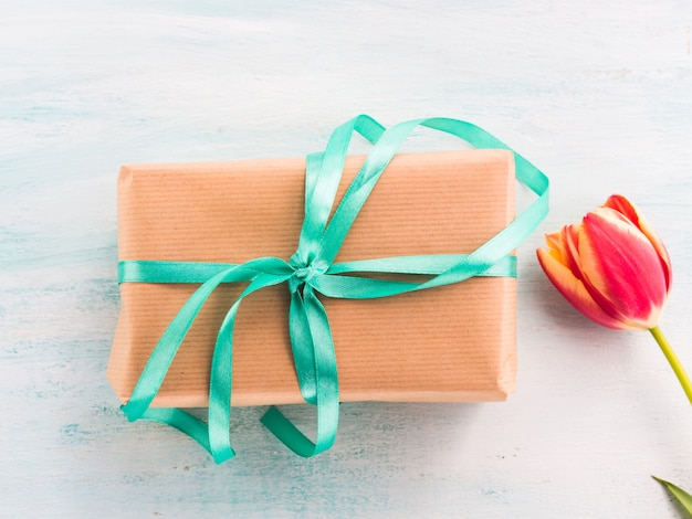 Gift box with green ribbon
