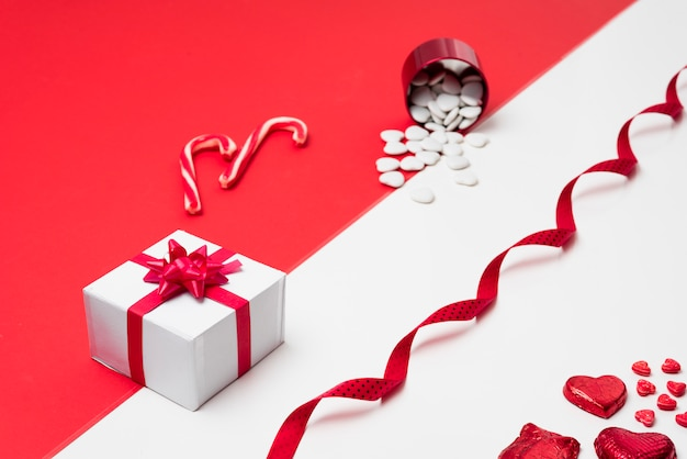 Gift box with hearts scattered fromcup