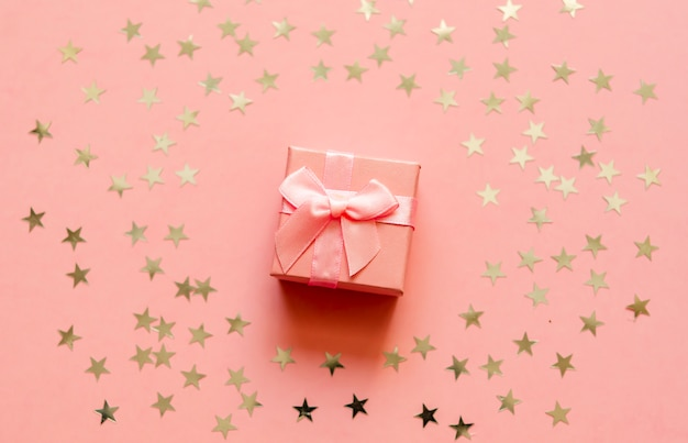 Gift box with holographic golden stars.