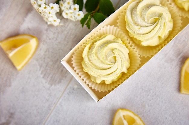 Gift box with homemade lemon yellow color marshmallows.