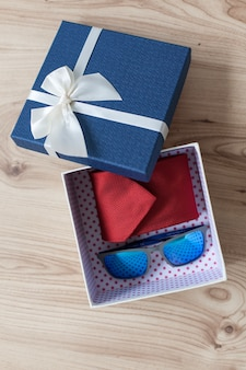Gift box with necktie and sunglasses
