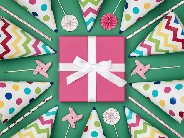 Gift box with party items on colorful background