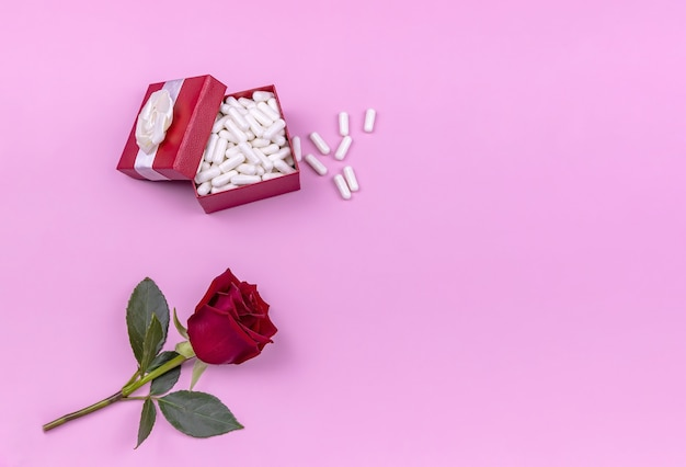 Gift box with pills and a rose