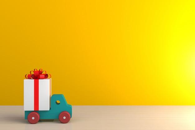 赤いリボンと木製のテーブル、黄色の壁の背景に白のギフトボックスの上の車のギフトボックス