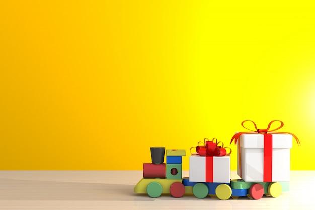 赤いリボンと木製のテーブル、黄色の壁の背景に白のギフトボックス上の列車のギフトボックス