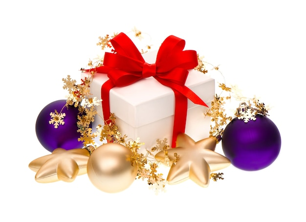 Gift box with red ribbon and christmas balls decoration on white background
