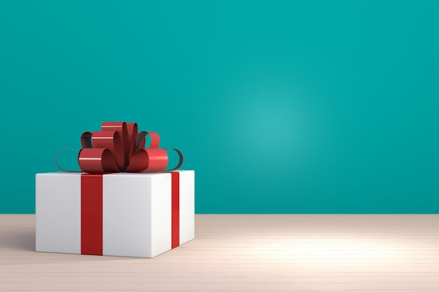나무 테이블에 빨간 리본, 공간을 가진 파란 배경에 백색 선물 상자 선물 상자