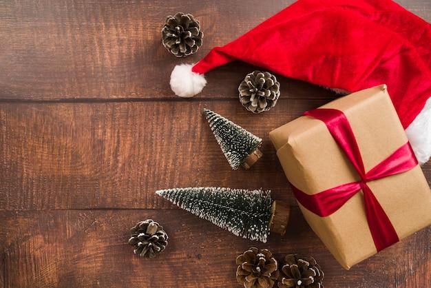 Gift box with red ribbon and santa hat