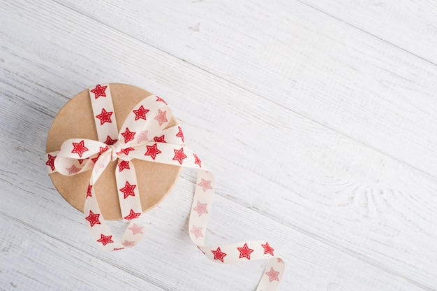 Gift box with red star ribbon