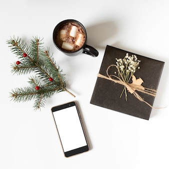 Gift box with smartphone on table
