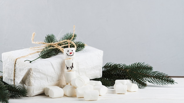 Gift box with snowman from marshmallows