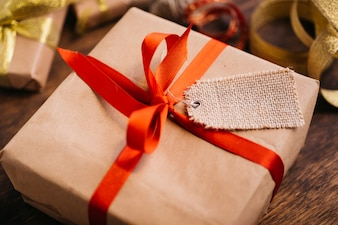 Gift box with tag on table