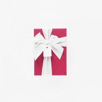 Gift box with tag on white table