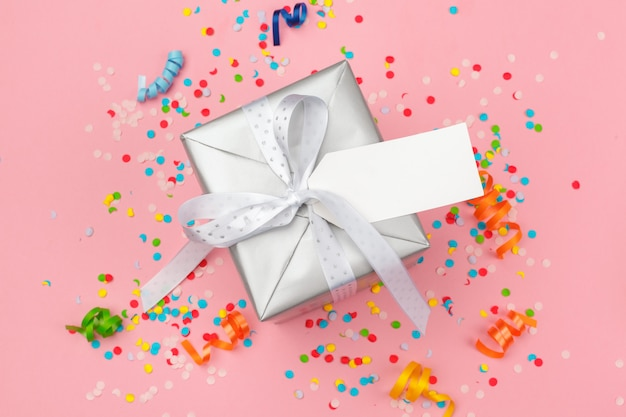 Gift box with various party confetti, streamers and decoration