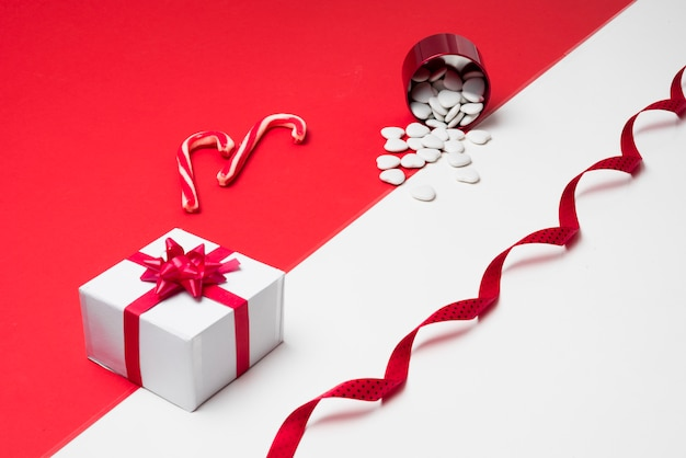 Gift box with white hearts scattered from cup