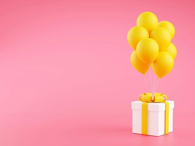 노란 리본과 분홍색 풍선 선물 상자
