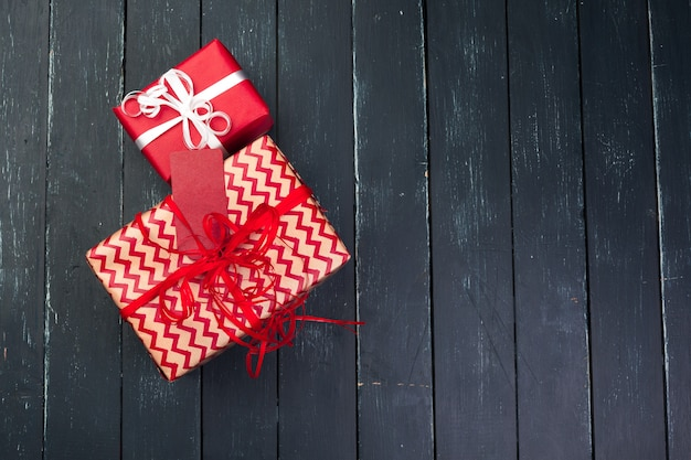 Gift box on wooden surface