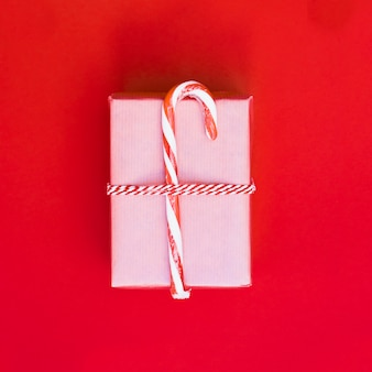 Gift box in wrap with candy cane