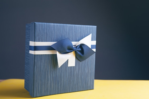 Gift box wrapped in kraft paper and bow