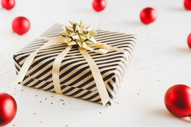 Gift box wrapped in kraft paper with golden ribbon