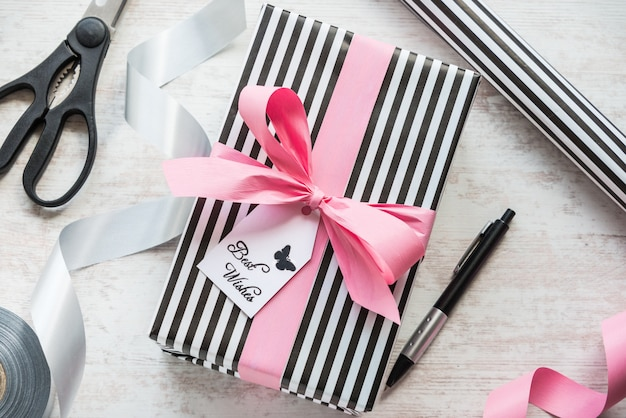 Gift box and wrapping materials on a white wood old background