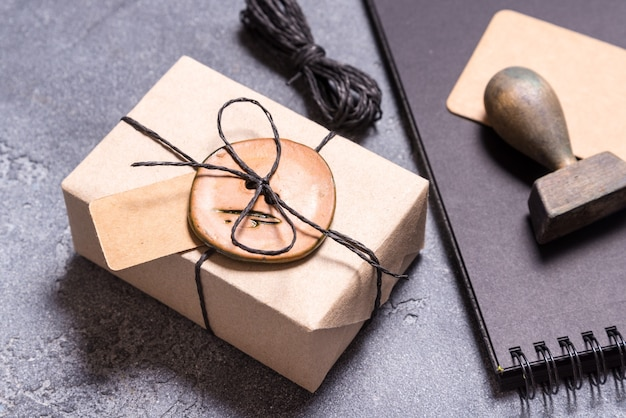 Gift box wrapping using button.