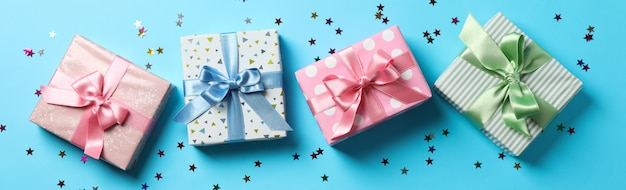 Gift boxes on blue background, top view and space for text
