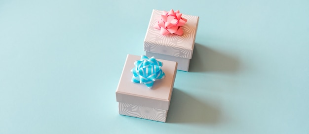 Gift boxes on blue surface