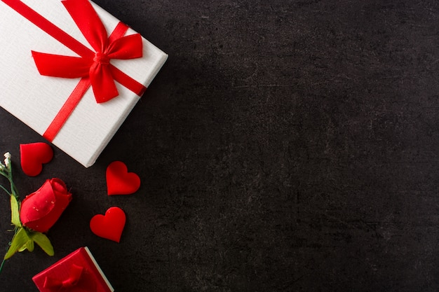 Gift boxes decorated with red hearts and red rose