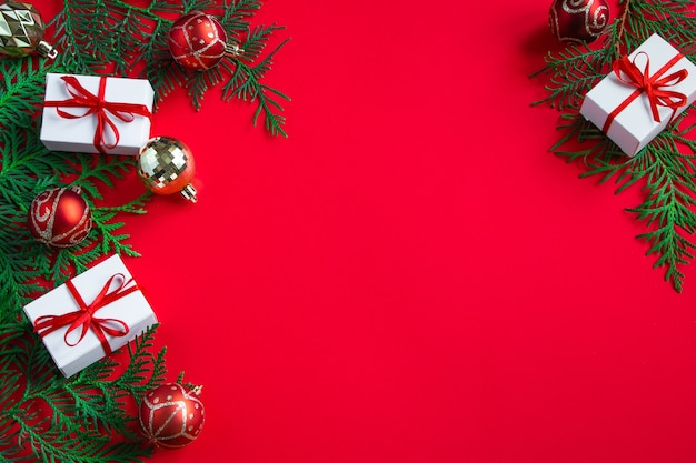 Gift boxes and festive decor. christmas composition on red background. place for text.