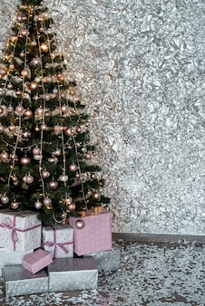 Gift boxes under fir tree for christmas or new year