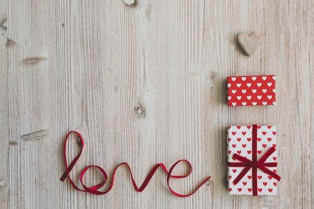 Gift boxes, a heart and the word