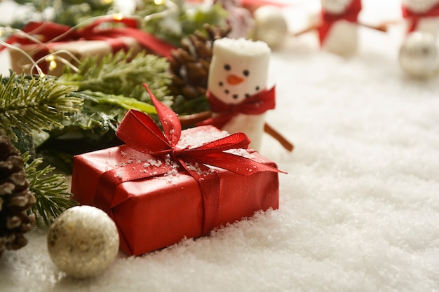 Gift boxes, marshmallow snow man, winter decorations, snow.